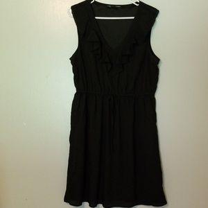 Maurice's black dress